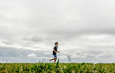 Danish boy running in a field