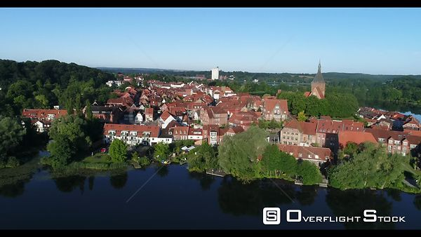 Old town area and inner city center with St. Nicolai church and school lake in Molln in the state of Schleswig-Holstein, Germany