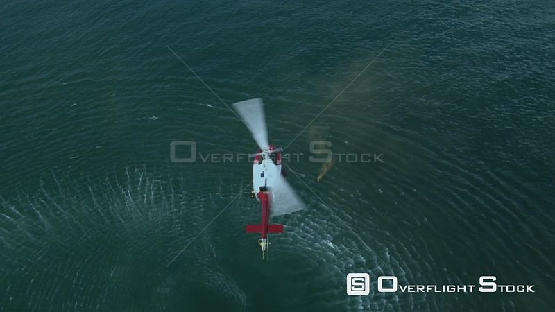 Aerial of a rescue helicopter hovering above a man in the ocean Cape Town Western Cape South Africa