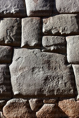 12 cornered Inca stone in Hatunrumiyoc Street , Cusco , Peru
