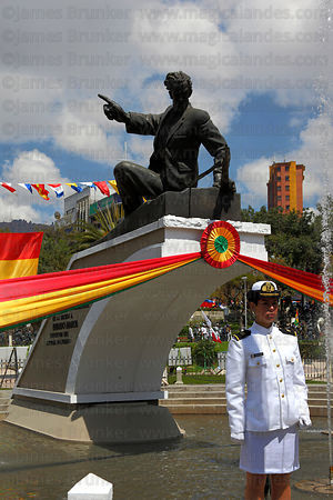 Female navy cadet standing in front of monument to Eduardo Abaroa during Dia del Mar / Day of the Sea , Plaza Avaroa , La Paz...