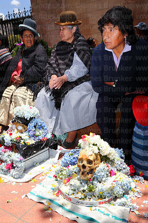 Women with their skulls in cemetery, Ñatitas festival, La Paz, Bolivia