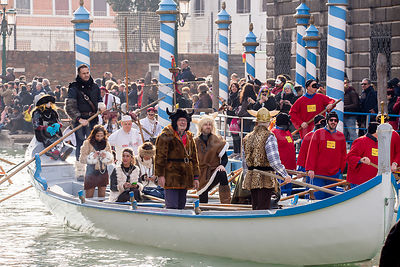 Men in Viking Helmets in the Venice Carnival Water Parade  on the Rio di Cannaregio Canal