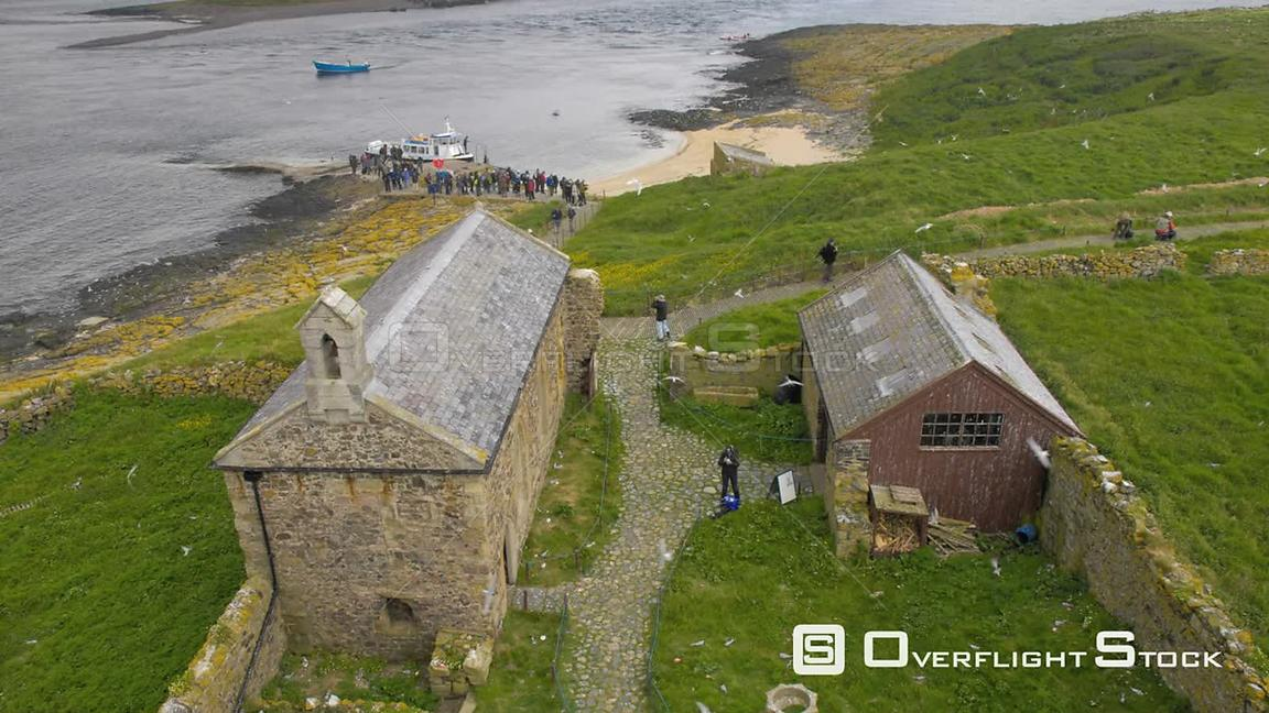 Timelapse of tourists arriving on the Farne Islands by boat, Northumberland, England, UK, July 2011