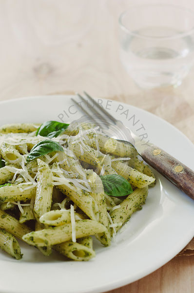 Pasta with Pesto on White Plate with Fork