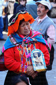 Indigenous devotee during Corpus Christi festival , Cusco , Peru