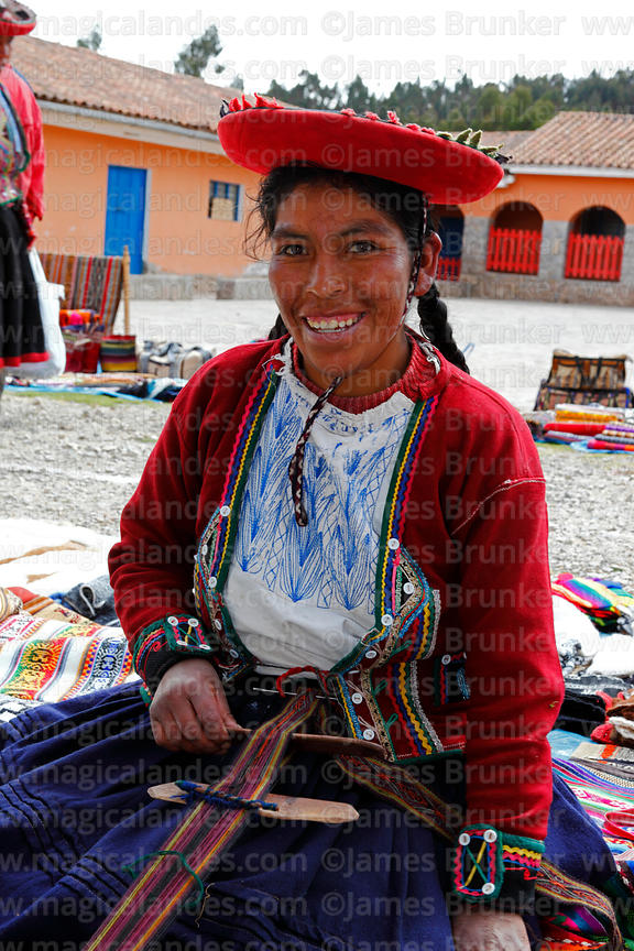 Quechua woman wearing traditional dress weaving at Chinchero market, Sacred Valley, Cusco Region, Peru
