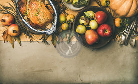 Thanksgiving dinner table setting with roasted chicken or turkey