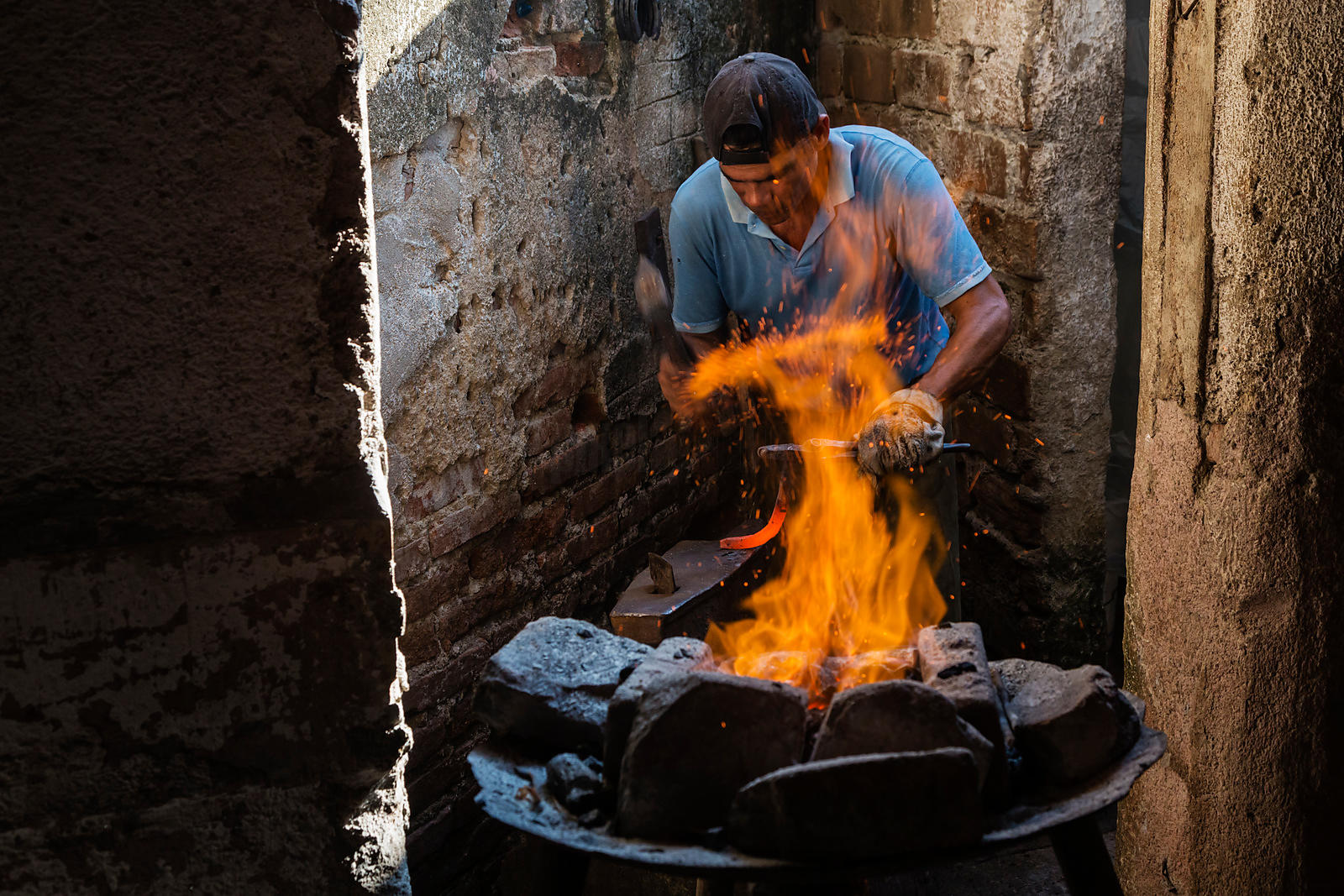 Blacksmith Making Horseshoes in a Home Forge