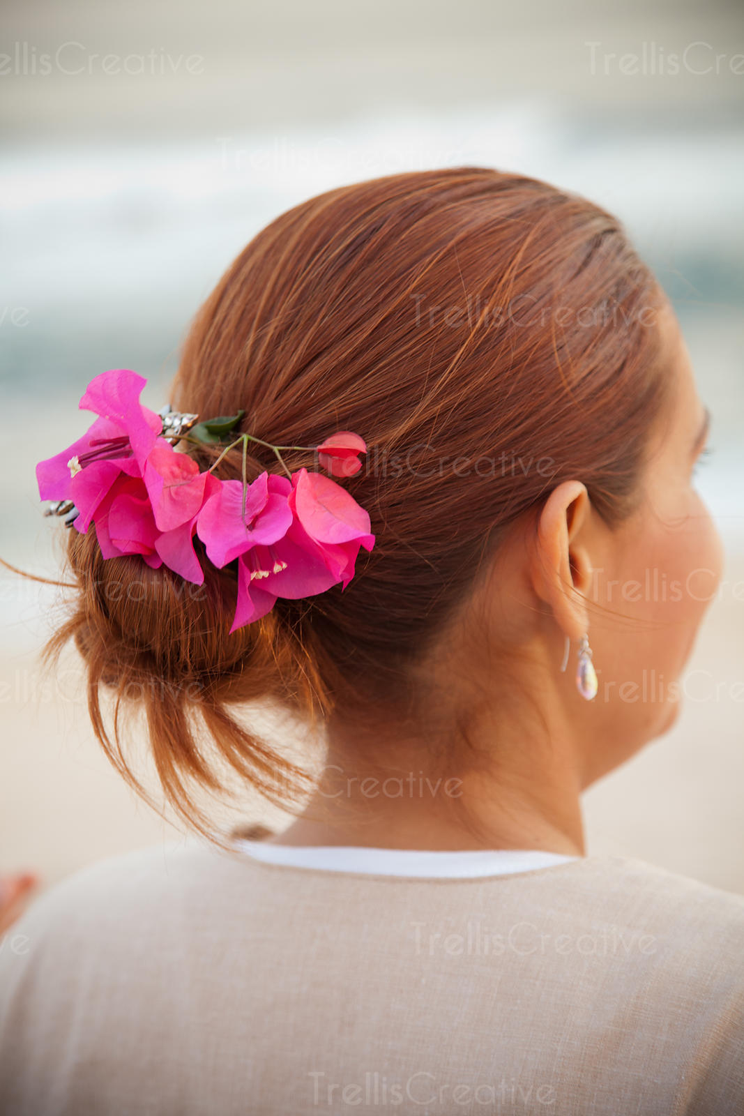 Bougainvillea flowers decorated in a young woman's hair
