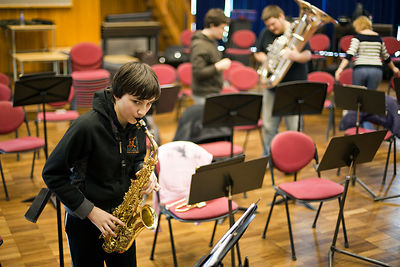 UK - Scunthorpe - Alex, 13 part of the Youth Concert Band practices his saxophone during a break in rehearsal of Cycle Song. ...