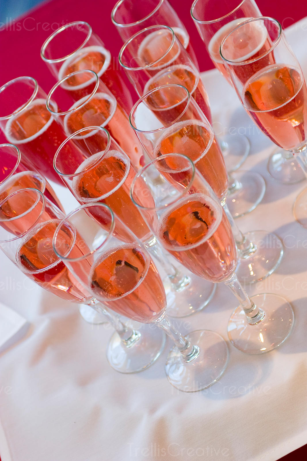 Glasses of pink rose sparkling wine waiting to be served