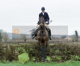 Maz Medcalf jumping the first hedge