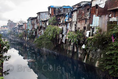 Latrines emptying directly into a canal in the Dharavi slum, Mumbai, India.