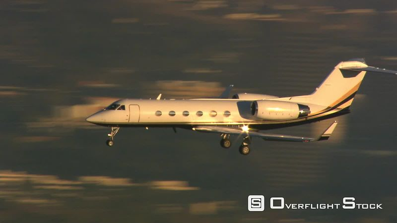 Control tower side view of executive jet preparing to land