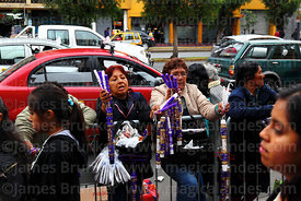 Women selling Señor de los Milagros candles in street outside Las Nazarenas church, Lima, Peru