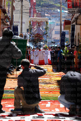 Photographers taking images of main procession of the Virgen de la Candelaria through the streets of Puno, Peru
