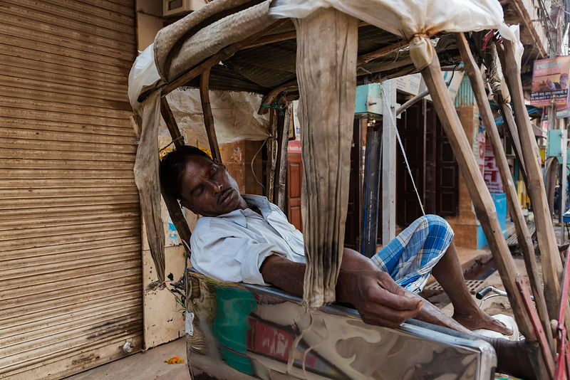 Rickshaw Driver Taking a Rest