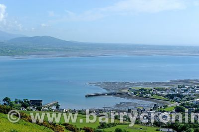 15th June, 2009. The village of Carlingford (with Taaffe's Castle in the bottom left of the photo) with the Mourne mountains ...