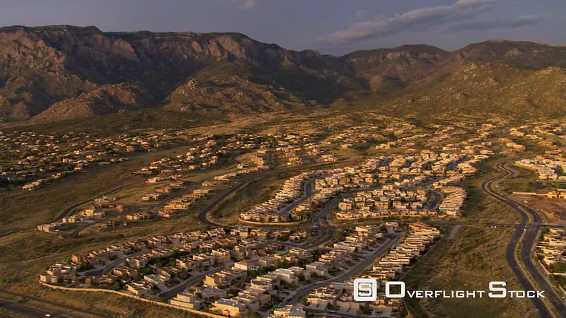 Flying over Albuquerque suburbs near Sandia Mountains.