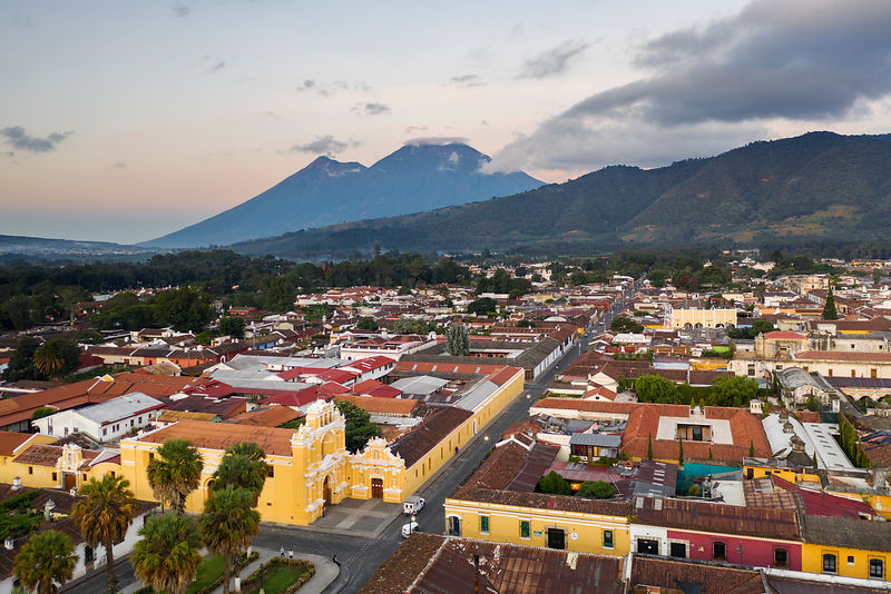 Aerila View of Antigua with Fuego and Acatenango Volcanoes in the Background at Dawn