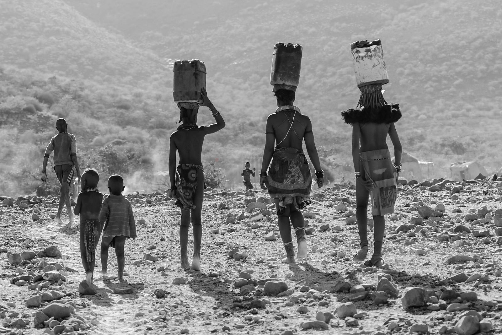 Himba Girls Carrying Water