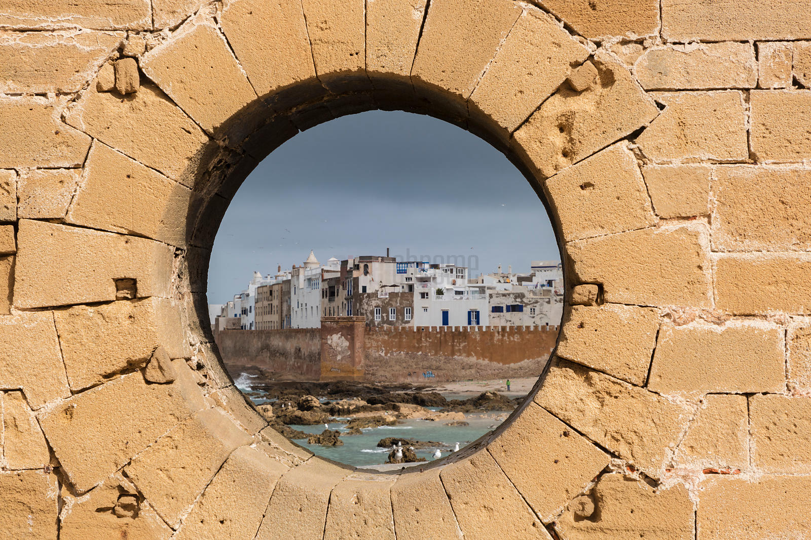 Essaouira Framed Through a Stone Hole in the Fortified City Wall