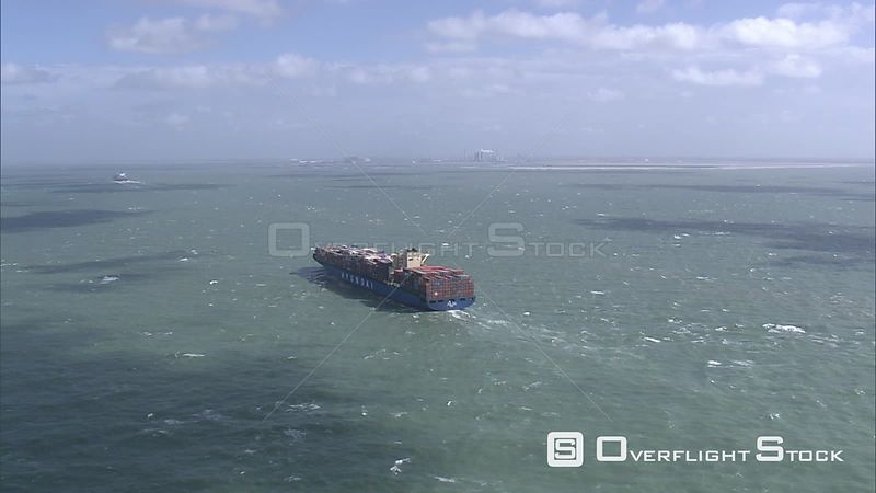 Container ship in the Port of Rotterdam, coastline in background