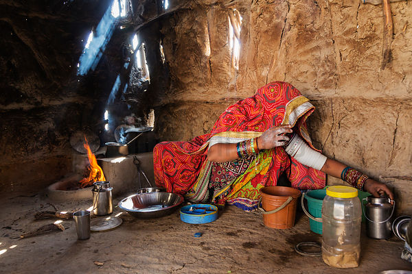 Woman Cooking in a Traditional Home