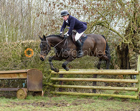 Meghan Healy jumping a hunt jump at Ladywood. The Cottesmore Hunt at The Priory