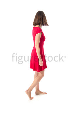 A woman in a red dress looking away – shot from eye level.