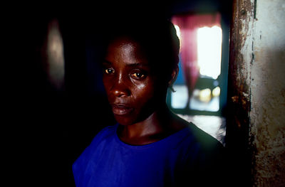 Angola - Luanda - Carolina, a resident of the Prenda slum at her house
