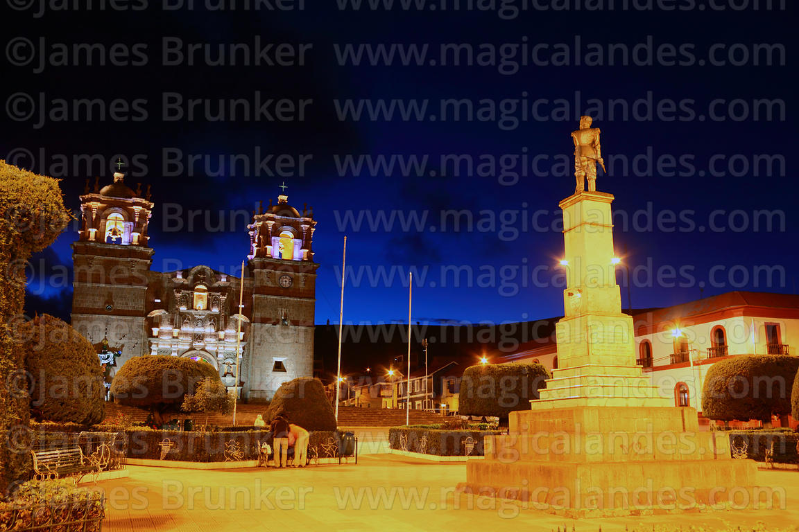 Monument to Colonel Francisco Bolognesi in Plaza de Armas and cathedral at night, Puno, Peru
