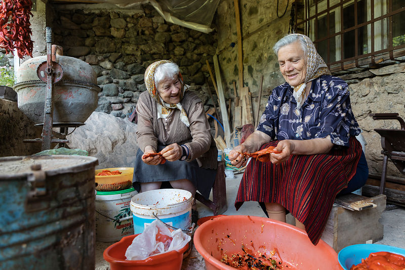 Women Preparing Ajvar from Fresh Peppers