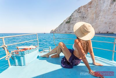 Woman on sailboat in the blue sea. Zakynthos, Greek Islands, Greece