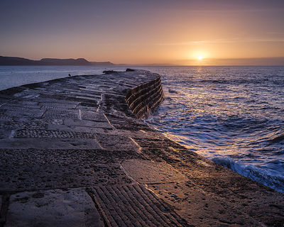 February_sunrise_on_the_Cobb_-_Lyme_Regis