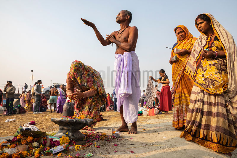 Pilgrims Performing a Puja Ritual after a Morning Dip in the Ganges