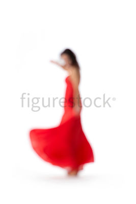 A dancing woman in a red dress – shot from mid level.