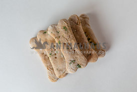 stacked homemade dog biscuits on white background