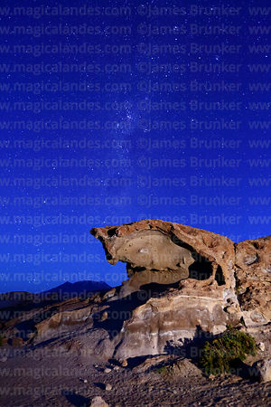 Eroded volcanic rock formation, Southern Cross and Milky Way, Cerro Caquella volcano in distance, Nor Lípez Province, Bolivia