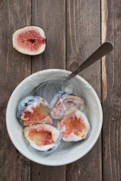 A bowl of freshly eaten figs.