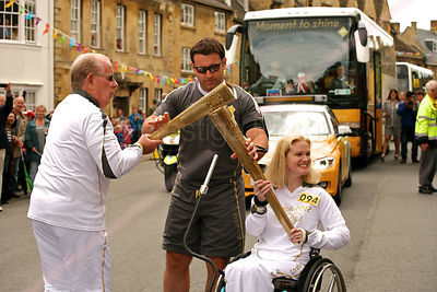 Met Police Officer Assists the Olympic Torch Changeover in Chipping Campden