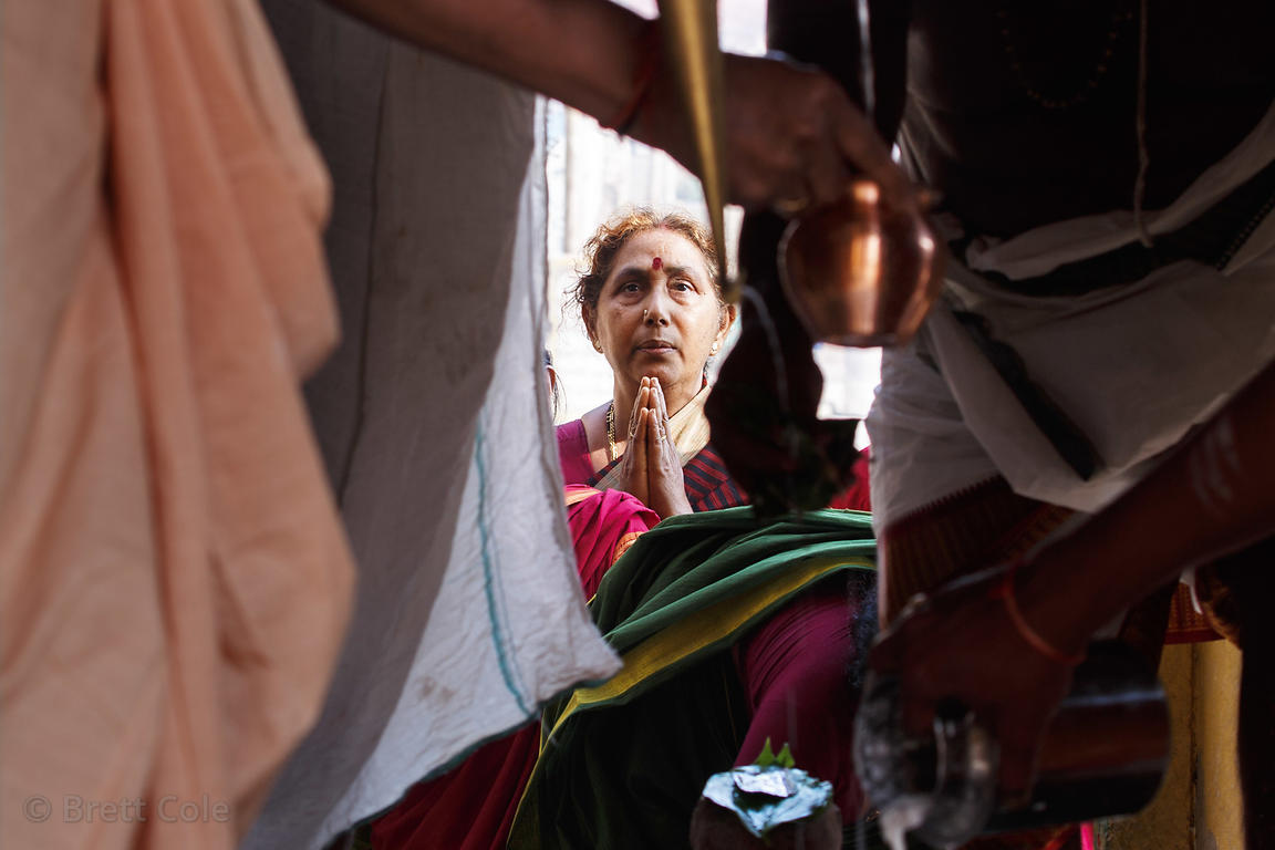 A Hindu woman prays at a temple, Manasarowar Ghat, Varanasi, India