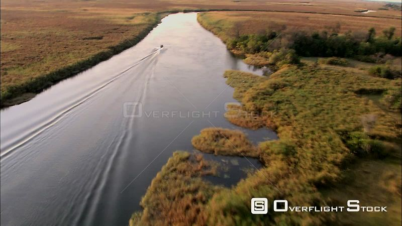 Aerial shot of a boat traveling down a river in Okavango Delta Okavango Delta Botswana Botswana