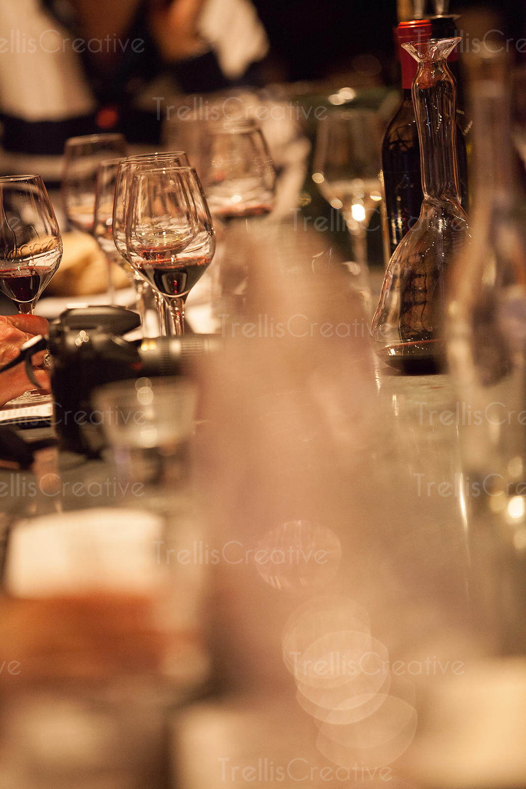 Port tasting obscured by glass in front of lens