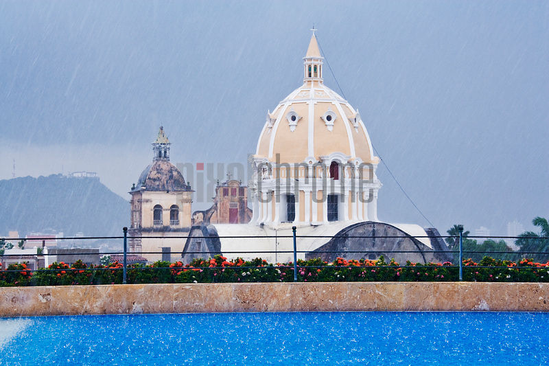 View of Iglesia de San Pedro Claver from Rooftop Pool during Rain Shower