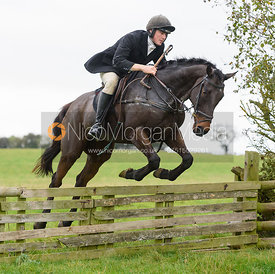 Rory Bevin jumping a hunt jump at Thorpe Satchville - Quorn Hunt Opening Meet 2016