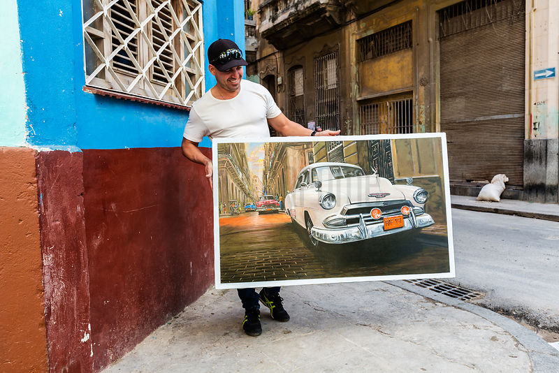 Artist Walking With Painting in Havana Street