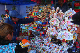 Miniature money bundles, houses and toy cars for sale in market for Alasitas festival, Puno, Peru