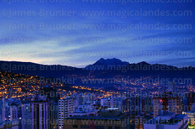 High rise buildings in Sopocachi and Mt Illimani before dawn, La Paz, Bolivia